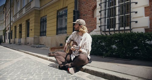 Man Playing Guitar in the Street