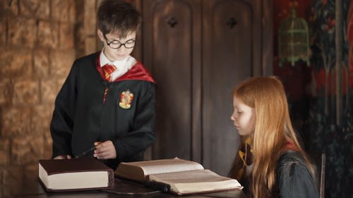 Kids Wearing Harry Potter Costume and Casting a Spell