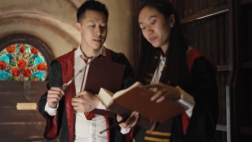 Young Adults Practicing A Spell