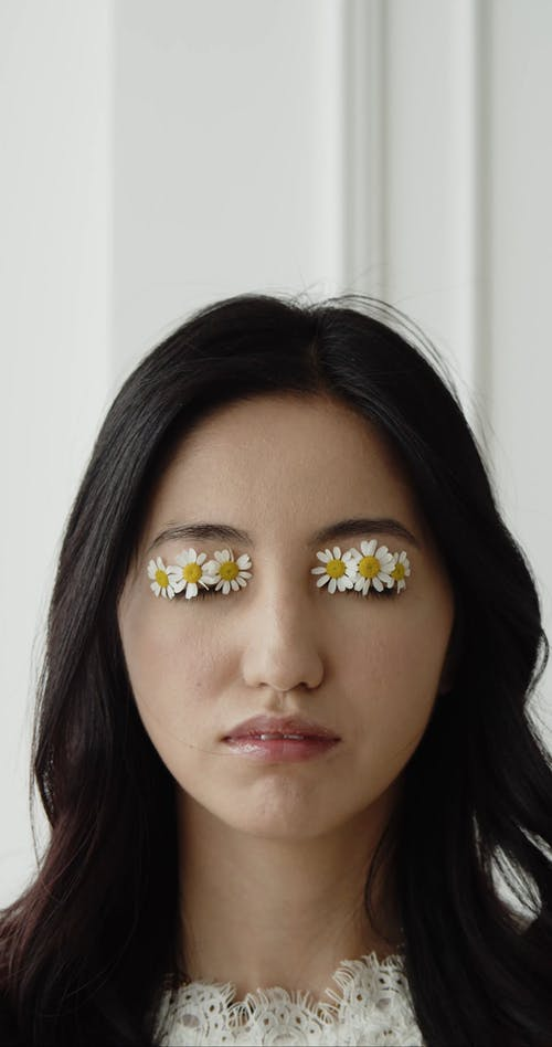 Woman With Flowers On Her Eyelids