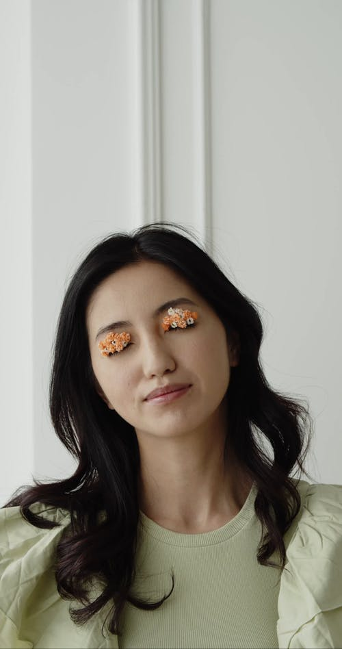 A Woman with Small Flowers on Eyelids