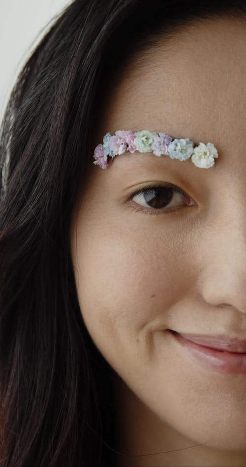 Woman With Flowers On Her Eyebrows