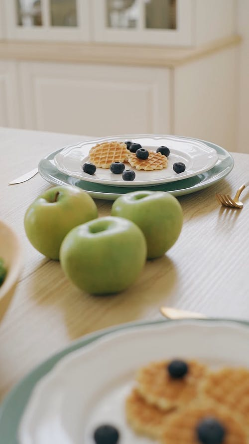 Waffles and Blueberries on the Plates