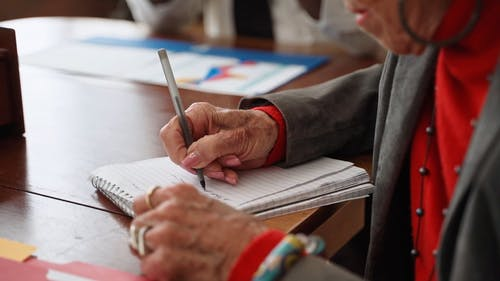 An Elderly Writing Notes