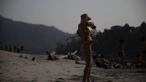 Video of a Woman using Hula Hoop