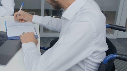Employees Taking Notes