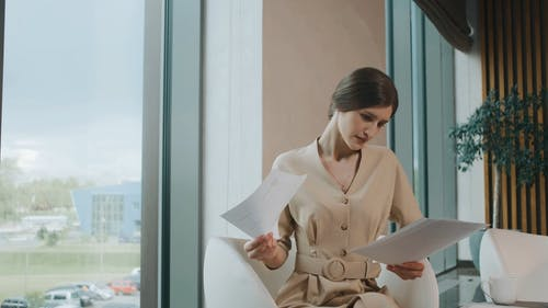 Businesswoman Analyzing Papers