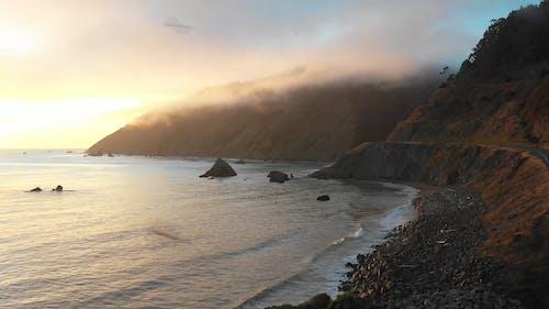 Drone Footage of Ocean Waves in Sunset