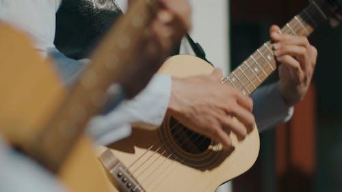Men Playing the Guitar While Singing