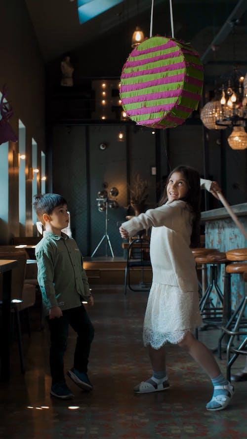 Little Girl Hitting a Piñata