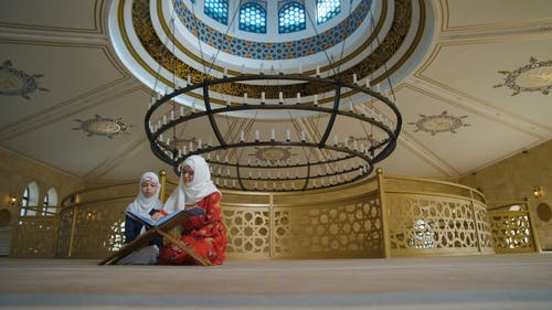 Girls Reading Prayers from Quran