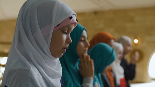 Children in Hijab Touching their Face