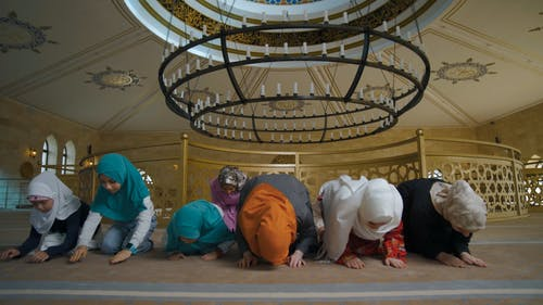 People Bowing Down to Pray
