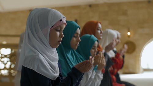 Group of Girls Offering their Prayers