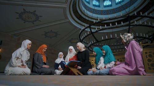 Women in Hijab Praying