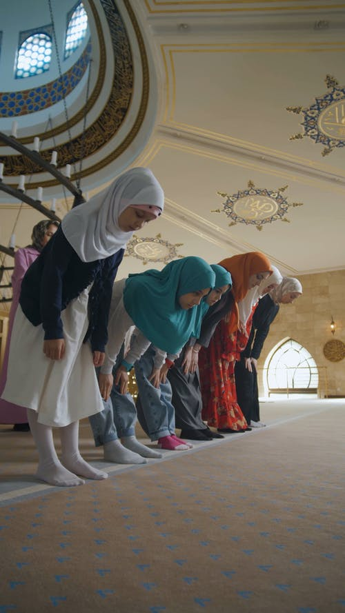 People Bowing Down and Kneeling while Praying