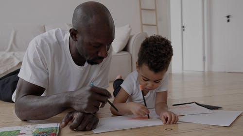 Father and Son Drawing Together