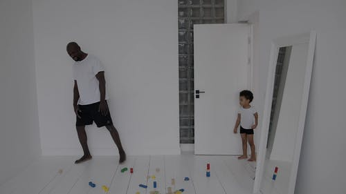 A Father And Son Bonding in The Playroom