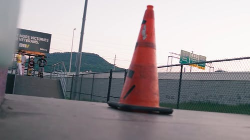 Skater Jumping Over a Traffic Cone