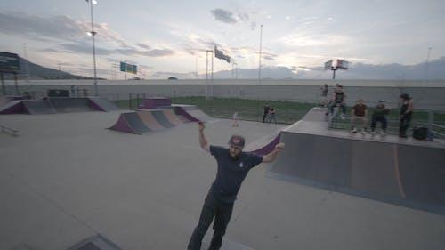 A Man Practicing Skateboarding Tricks in the Skate Park