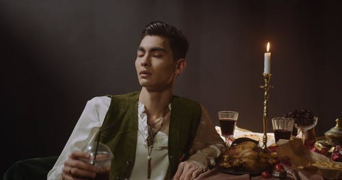 Man in Baroque Wear Drinking an Iced Cold Drink