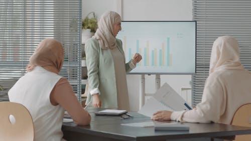 Woman Presenting at a Meeting