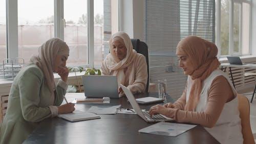 Women Using Laptop at Work