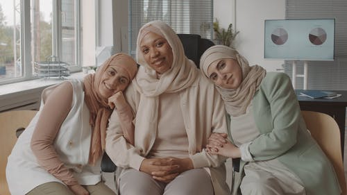 Women Posing at an Office
