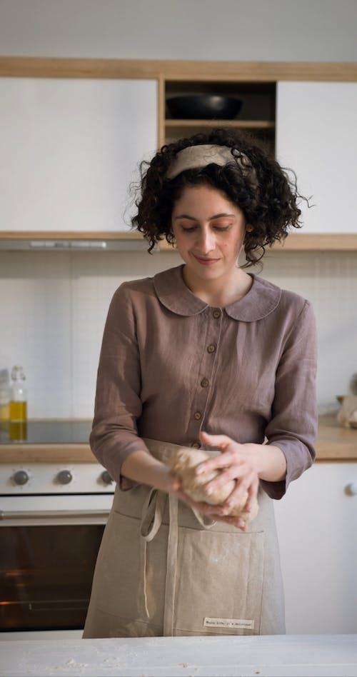 A Woman Kneading a Dough