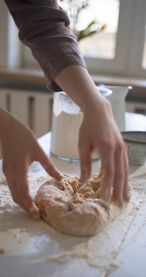 A Person Kneading a Dough