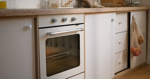 A Woman Checking the Oven