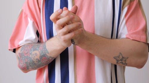 A Man Rubbing His Hands