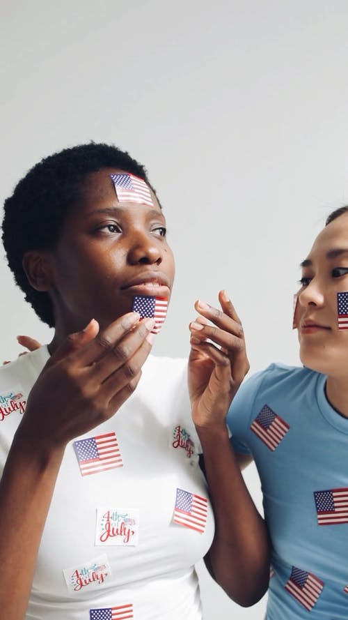 Women Playing with USA Stickers