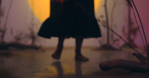 Woman Shaking a Tambourine