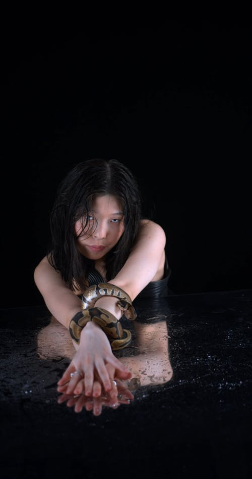 A Woman Holding a Snake