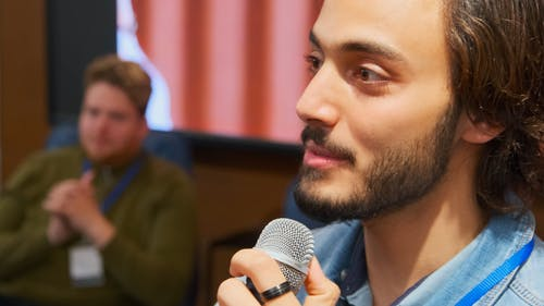 Man Talking on the Microphone