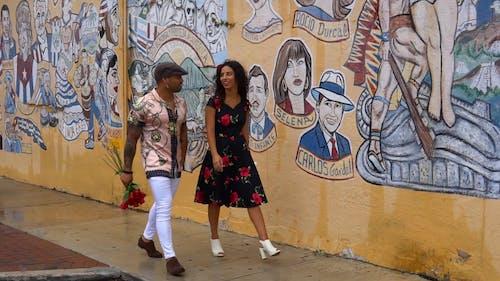 Man and Woman Walking the Sidewalk