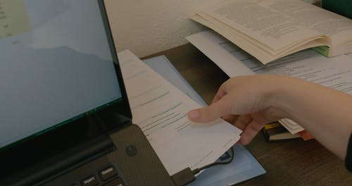 A Woman Looking at the Documents