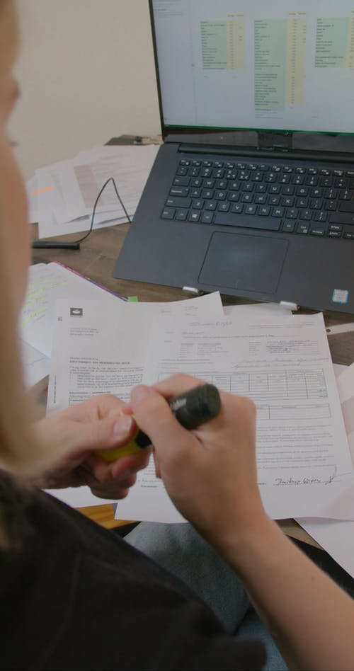 A Woman Marking the Documents