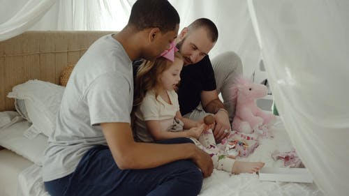 Girl Eating While Talking to Her Parents