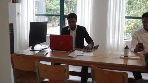 Male Colleagues Working Together in an Office
