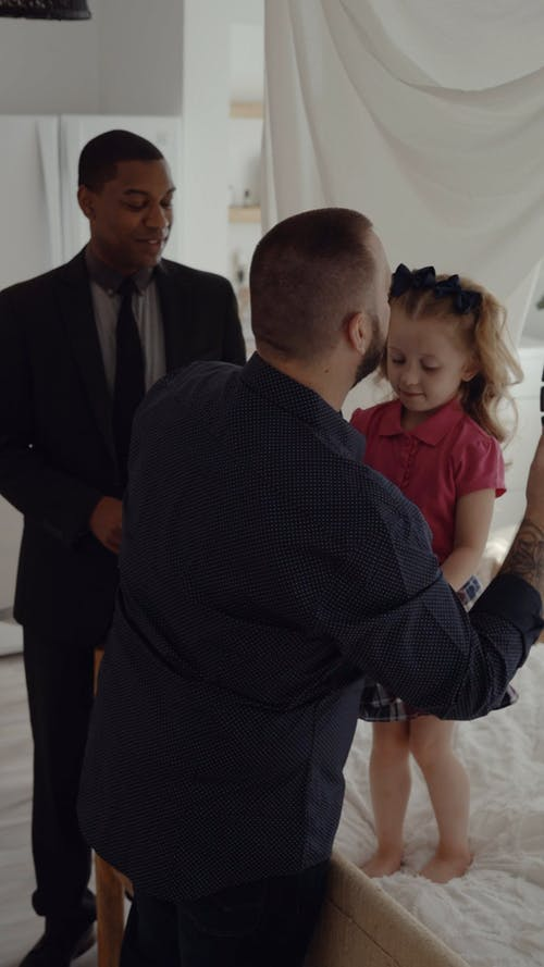 A Father Brushing the Hair and Dressing Up Her Daughter