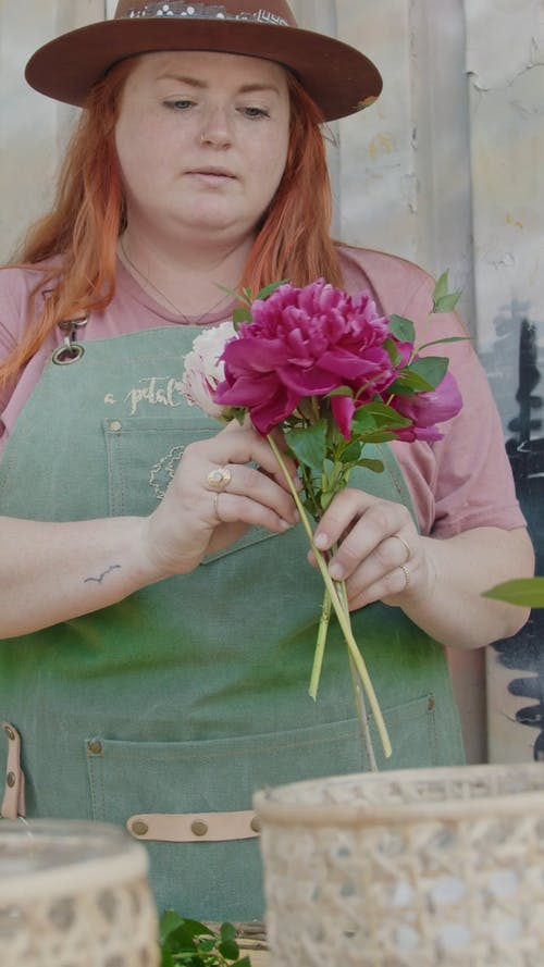 A Woman Arranging a Bouquet of Flowers