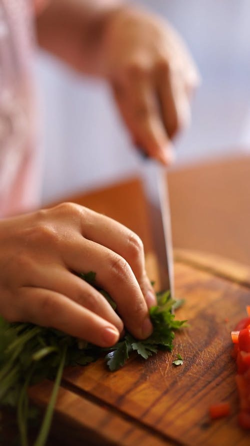 A Person Cutting Vegetables