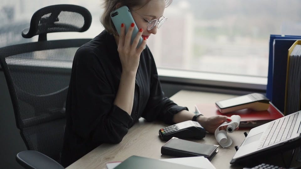 Woman At The Office Talking On The Phone