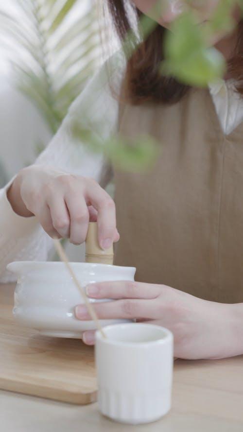 A Woman Stirring in a Bowl