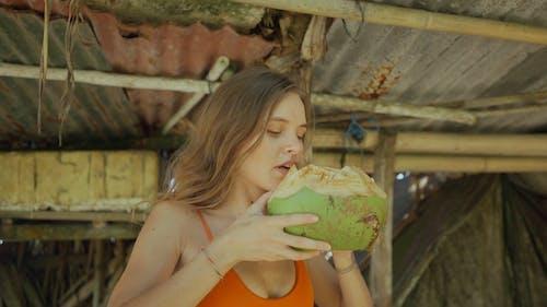 Woman Drinking Coconut Juice