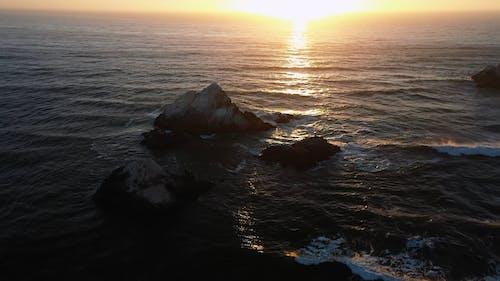 Waves Crashing on Stones