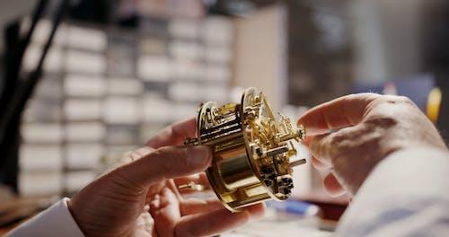 Person Repairing A Clock