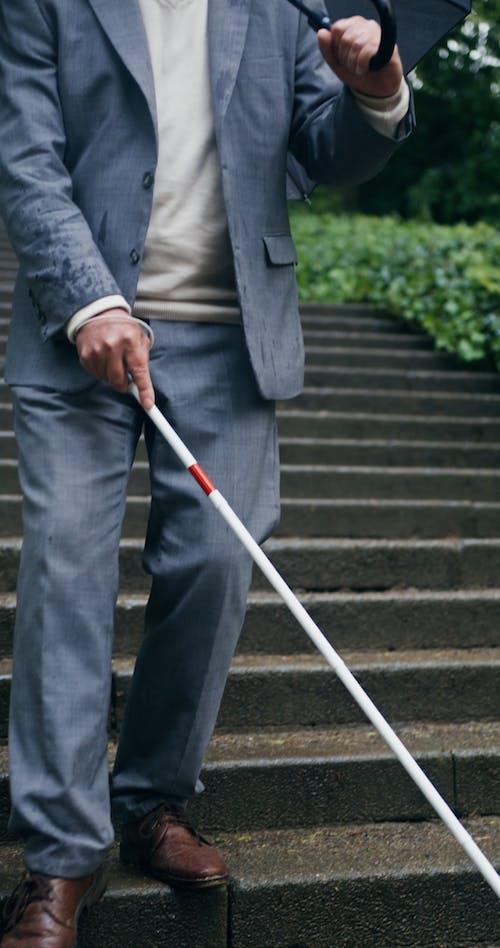 Elderly Man Walking Down the Stairs